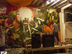 Graffiti artists from Tokyo and London come indoors to paint the East wall of Passing Passing Clouds as the sun goes down